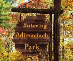 Entering Adirondack Park sign in the fall