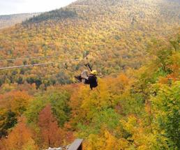 zipliner and fall foliage in the mountains