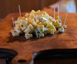 cut up cheese on a cutting board
