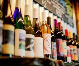a row of wine bottles on a shelf