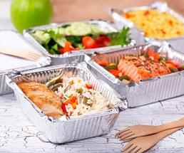 multiple takeout containers filled with food