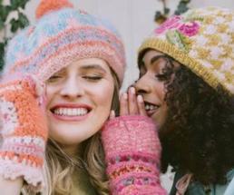two women wearing winter hats