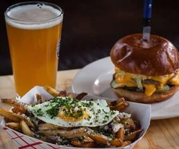 burger, fries, and glass of beer