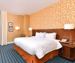 a bed and guest room in a hotel