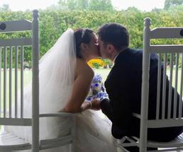 bride and groom in chairs kissing