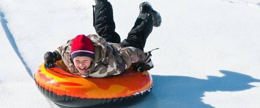kid on a snow tube