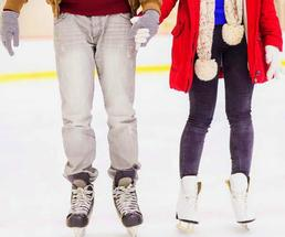 people holding hands while ice skating