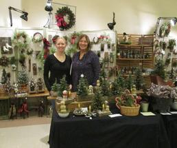 two women at holiday market booth