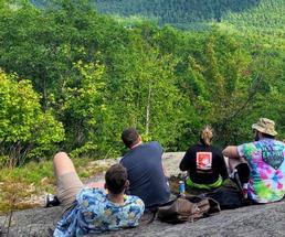 group on a mountain summit