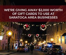 saratoga street decorated for the holidays with text announcing giveaway
