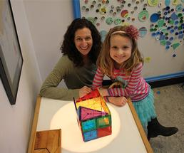 a mother and daughter in an interactive museum