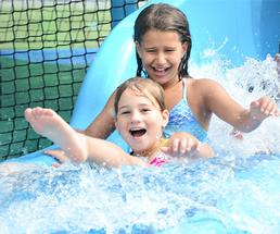 two girls going down a waterslide