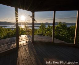 sunset behind a gazebo in lake george