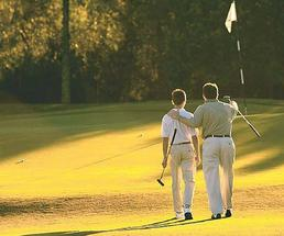 father and son golfing together