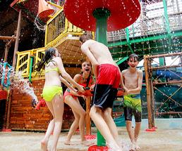 kids playing in an indoor water park