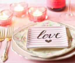 the word love on a plate