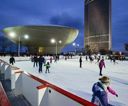 people ice skating at empire skate plaza