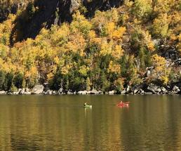 two people kayaking in the fall