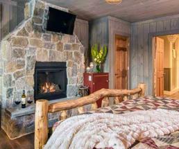 fire in fireplace in bedroom