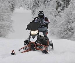 one person riding a snowmobile