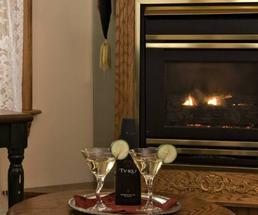 two drinks by a fireplace