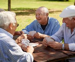 old men playing cards outside