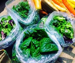 bagged spinach next to carrots