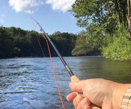 fishing rod over lake