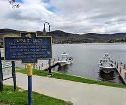 historical marker pointing out lake george's sunken fleet