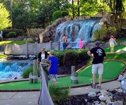 people at a mini golf course