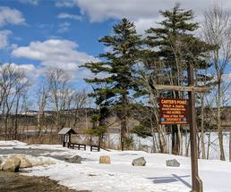 carters pond sign in winter