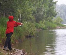 person in red coat fishing