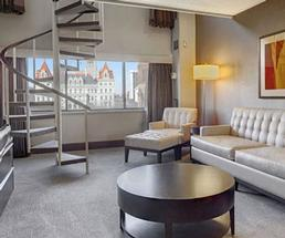 spacious living room in a hotel room