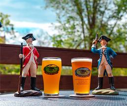 two pints of beer with two revolutionary war figurines