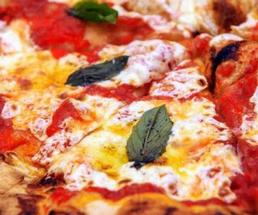 close up photo of pizza with cheese and basil
