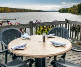 a table set up on a deck by water