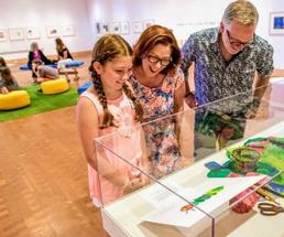 parents and kid at museum