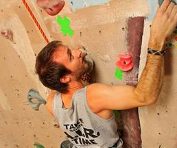 man climbs wall