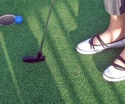 person mini golfing