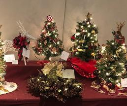 small decorated trees on a table