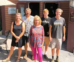 sutton family standing outside farmstead flatbread