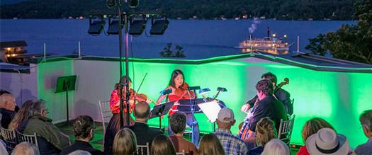 chamber music group performing on a rooftop