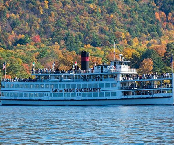 steamboat in front of fall foliage