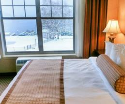 hotel bed by window