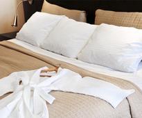 bathrobe on hotel bed
