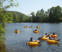people floating in tubes on a river
