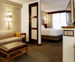 hotel room with bed, couch, and other amenities