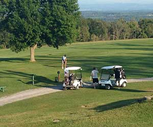 golf carts and golfers in lake george