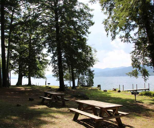 picnic tables and grills on speaker heck island overlooking lake george