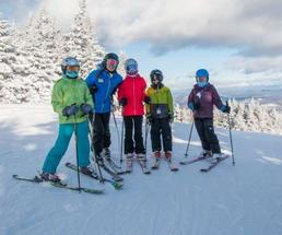 group of four skiers on hill